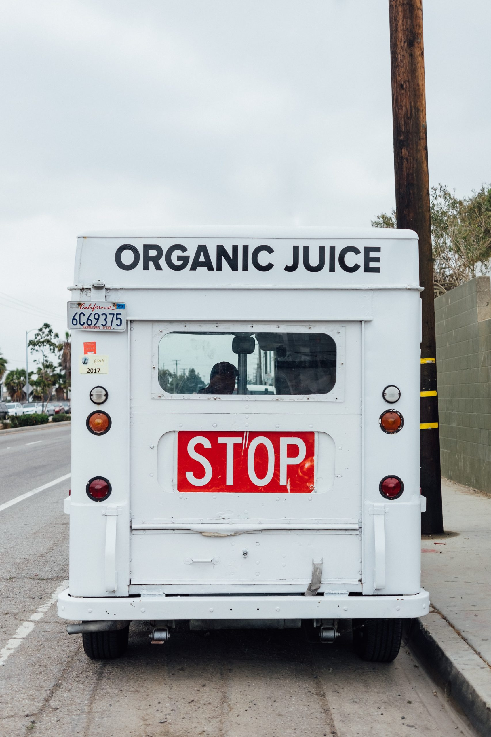 back of step van white organic juice van
