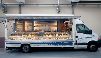 mobile bakery food truck for selling on public markets, france.